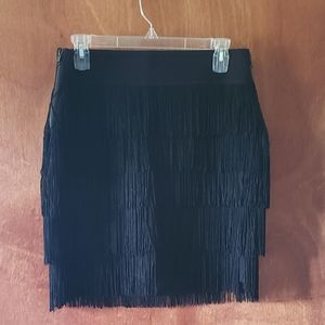 BCBG black mini skirt with fringe